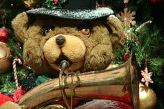 Christmas band. Christmas teddy bear playing saxophone stock photography