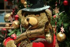 Christmas band. Christmas teddy bear playing saxophone stock image