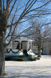 Christmas Bandstand. A country village bandstand is ringed with Christmas garland Stock Photos