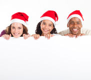 Christmas banner. Happy multiracial family holding an empty Christmas banner on white Royalty Free Stock Photography