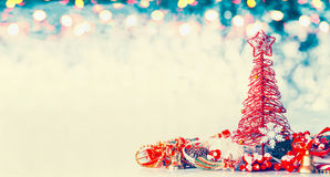Christmas banner background with red tree, star and festive decoration on blue winter bokeh Royalty Free Stock Photos