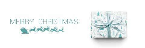 Christmas banner. Beautiful christmas gift isolated on white background. Turquoise colored wrapped xmas box. Gift wrapping concept royalty free stock photo