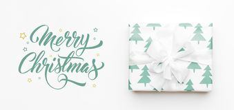 Christmas banner. Beautiful christmas gift isolated on white background. Turquoise colored wrapped xmas box. Gift wrapping. royalty free stock image