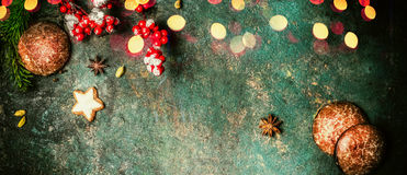 Christmas banner with fir branches, cookies , gingerbreads and festive bokeh lighting, top view stock photography