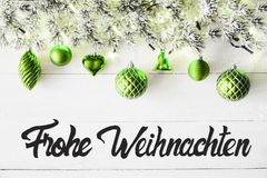 Green Balls, Calligraphy Frohe Weihnachten Means Merry Christmas. Christmas Banner With German Calligraphy Frohe Weihnachten Means Merry Christmas. Fir tree royalty free stock image
