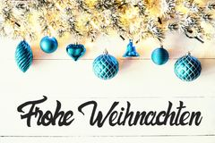 Turquoise Balls, Calligraphy Frohe Weihnachten Means Merry Christmas. Christmas Banner With German Calligraphy Frohe Weihnachten Means Merry Christmas. Fir tree stock image