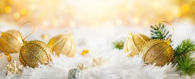 Christmas banner with gold baubles Royalty Free Stock Photo