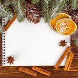 Christmas banner with green tree, cones, handmade felt decorations, orange and cinnamon on white wooden background. Empty space for text. Xmas and New Year Royalty Free Stock Images