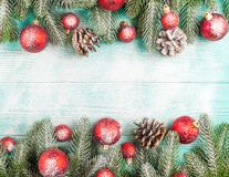 Christmas banner with green tree, red and white handmade felt decorations on white wooden textured background Royalty Free Stock Image