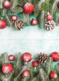 Christmas banner with green tree, red and white handmade felt decorations on white wooden textured background Royalty Free Stock Images