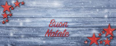 Christmas greeting banner with Portuguese text on wood table Royalty Free Stock Photography