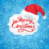 Christmas banner and hat of Santa Claus Royalty Free Stock Image