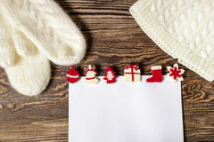 Christmas banner. Letter to Santa Claus. Wish list. Winter background. Hands in mittens Royalty Free Stock Images
