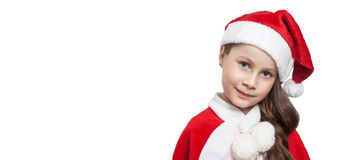 Christmas Banner with Little Girl Smiling. on White Background with copy Paste. Red Hat. royalty free stock images