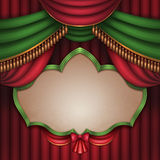 Christmas banner over red and green theater stage curtain background Stock Photos