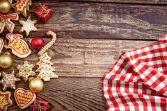 Christmas banner. Plaid tablecloth and Xmas cookies. Copy space, mock up.  stock photography