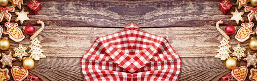 Christmas banner. Plaid tablecloth and Xmas cookies. Copy space, mock up.  stock images