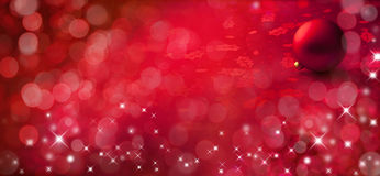 Christmas Banner Red Background. A red Christmas banner background with lights and sparkle Stock Images