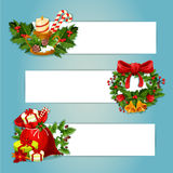 Christmas banner set with gift and holly wreath. Christmas banner with copy space and holly berry composition. Gift bag with present box, pine and ilex wreath Royalty Free Stock Photos