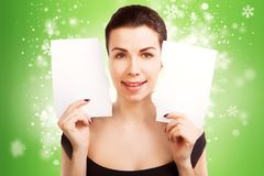 Christmas Banner sign woman with  blank empty paper billboard. With copy space for text Royalty Free Stock Images