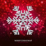 Christmas banner silver snowflake on a red background. Christmas banner with glowing silver snowflake on a dark red background. Happy New Year poster Stock Images