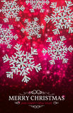 Christmas banner silver snowflakes on a red background. Christmas banner with glowing silver snowflakes on a dark red background. Happy New Year poster Royalty Free Stock Images