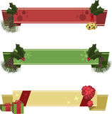 Christmas Banners. Three Christmas-themed blank red, green, and gold banners, decorated with jingle bells, holly, pine cones, pine needles, ribbons, bows, and Royalty Free Stock Photos