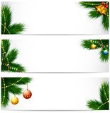 Christmas banners with pine tree branch, balls and golden bells and light bulbs Royalty Free Stock Image