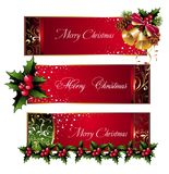 Christmas banners with pinecone,bells and holly Royalty Free Stock Images