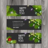 Christmas banners set with fir branches decorated with ribbons, red balls and garlands on wood background. Vector eps 10. Christmas banners set with fir branches Royalty Free Stock Photo
