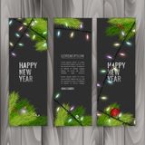 Christmas banners set with fir branches decorated with ribbons, red balls and garlands on wood background. Vector eps 10. Christmas banners set with fir branches Royalty Free Stock Image