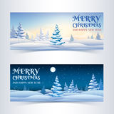 Christmas banners set with snowy fir trees Stock Image