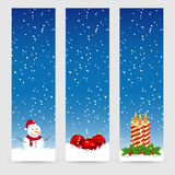 Christmas banners. With snowman, balls and candles under snow Royalty Free Stock Photography