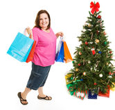 Christmas Bargain Shopper. Pretty plus sized woman excited about bargain shopping for Christmas.  Full body isolatedo on white Stock Image