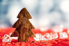 Christmas bark tree shape on ice cubes Stock Photography