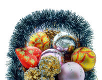 Christmas basket. A set of Christmas decorations, balls, heart, cones and basket Stock Photo
