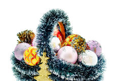 Christmas basket. A set of Christmas decorations, balls, cones and basket Royalty Free Stock Image