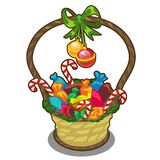 Christmas basket with candies, lollipops and balls Stock Images