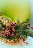Christmas basket with cones, branches and berries. Place for text. Postcard stock photo