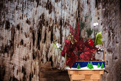 Christmas Basket On A Decayed Wood Background Stock Photos