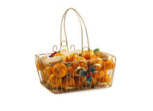 Christmas basket with fresh clementines , nuts and cookies. Stock Photography