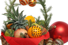 Christmas basket with fruit. Decorated Christmas basket with fruit, isolated on white background Stock Photography