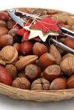 Christmas basket with nuts and nutcracker Royalty Free Stock Images