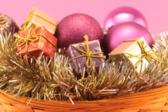 Christmas basket on pink background Stock Images