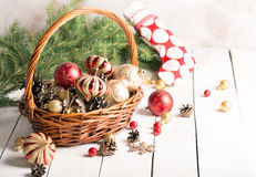 Christmas basket with red and golden ornaments Stock Images