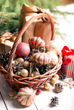 Christmas basket with red and golden ornaments, Royalty Free Stock Photography