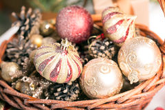 Christmas basket with red and golden ornaments Royalty Free Stock Photos