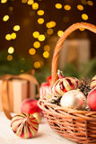 Christmas basket with red and golden ornaments Stock Photo