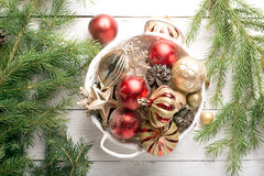 Christmas basket with red and golden ornaments Royalty Free Stock Image