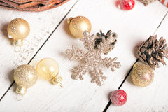 Christmas basket with red and golden ornaments Royalty Free Stock Photography